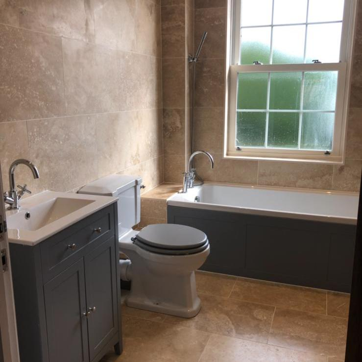 Image 88 - Traditional bathroom installed finished in natural travertine tiles