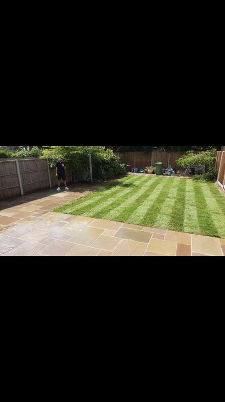 Image 9 - Indian sandstone patio new hard wearing turf installed