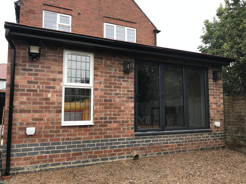 Image 29 - Single storey extension. The family home in Burton upon Trent was redesigned with a rear extension to create a new kitchen and dining area. Velux roof windows and Bi-fold doors were installed which open out onto the garden.