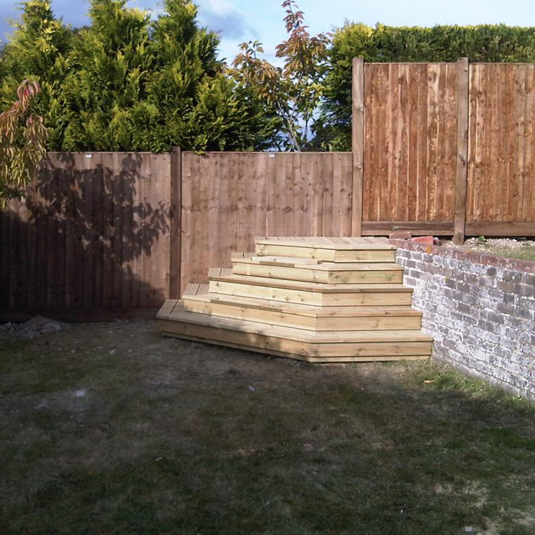 Image 25 - A customer had a garden on two levels and wanted a couple of access points. This set of steps had removable sections to grow plants in.