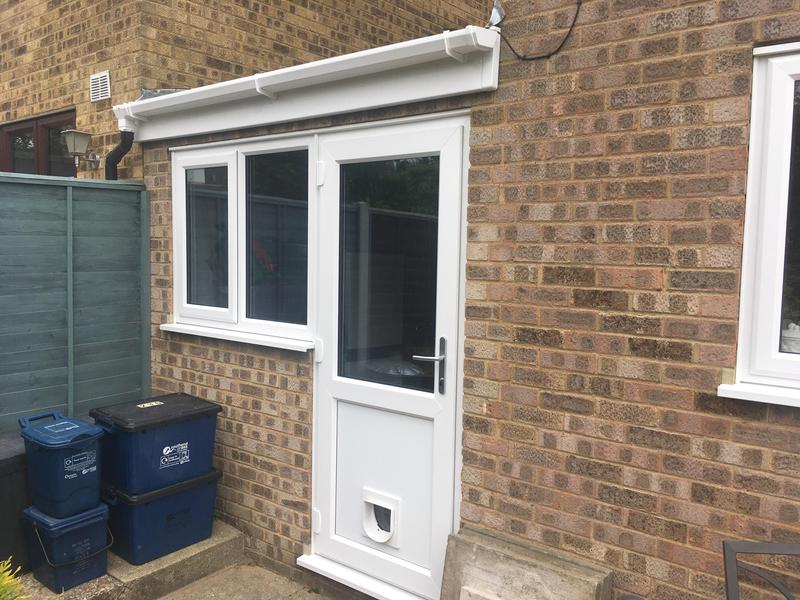 Image 111 - Eastwood-White UPVC white panel door with cat flap