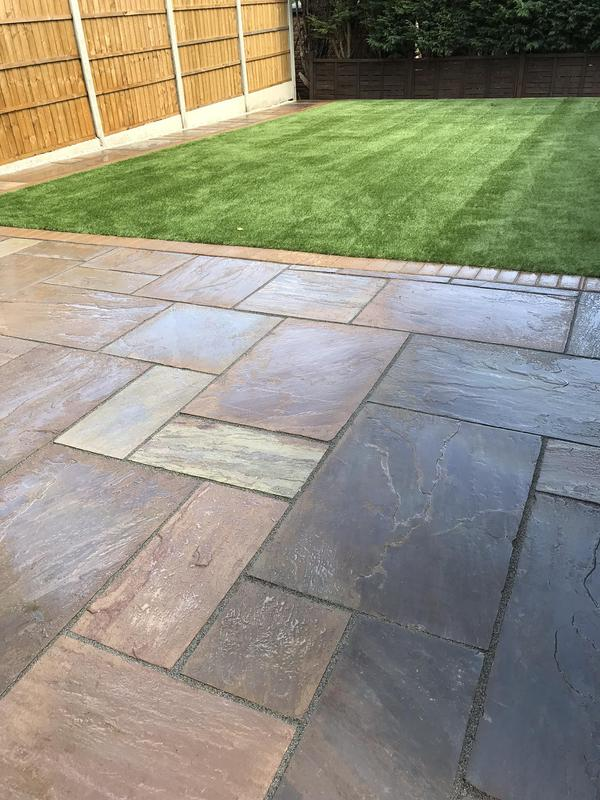 Image 36 - Indian sandstone paving with a Artificial turf new fence