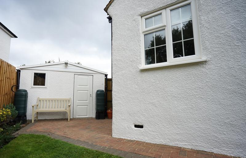 Image 184 - Pebble dashed House in Brilliant White Duluix Weathershield.