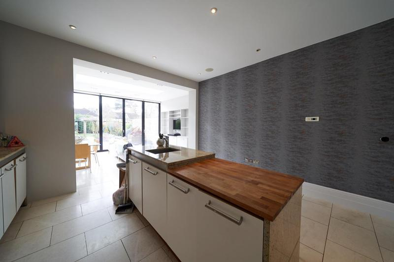 Image 19 - Painting & Decorating in Beckenham. Lovely light & spacious feeling in this large kitchen. F&B 'Ammonite' to the walls and TV unit. Feature wallpaper wall.