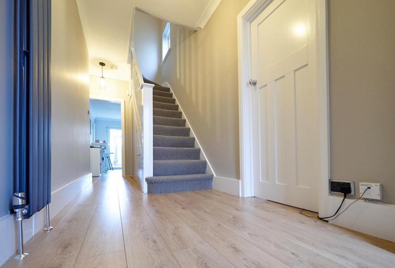 Image 77 - Stunning hallway in Bickley. F&B 'Elephants Breath' on all walls and we suggested colour matching the under stairs storage & door in the same colour.