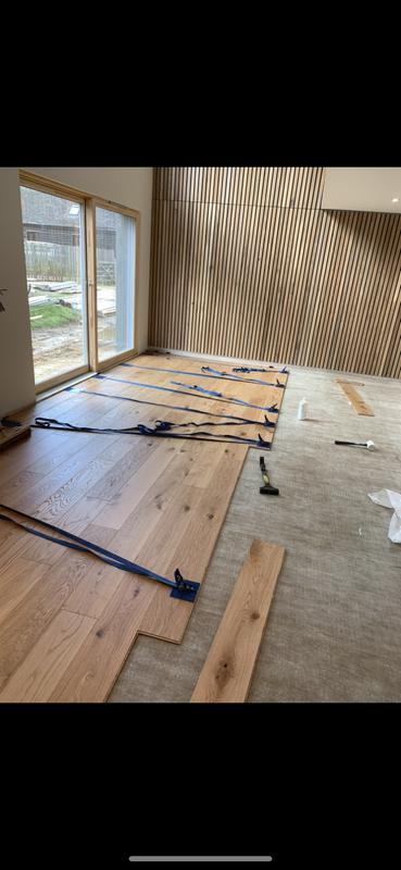 Image 5 - A sneak peak of a job half way through completion. This is a tongue and groove engineered wood floor that is glued together!