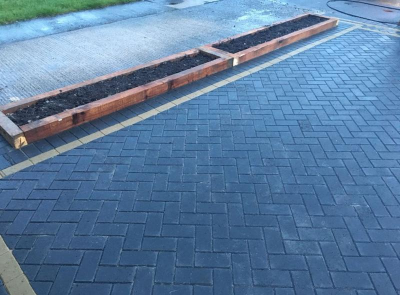 Image 40 - Charcoal paving with railway sleeper in the middle