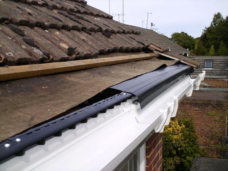 Image 9 - installing new facias soffit and guttering and a new drip tray to stop water from rotting bottom of felt
