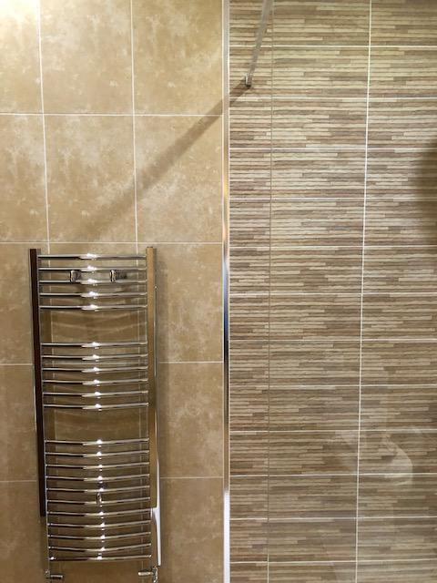 Image 6 - Contrast tiles to shower area, chrome heated towel rail.
