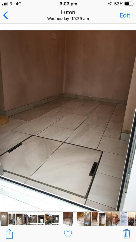 Image 47 - Fitted new man hole lid and tiles