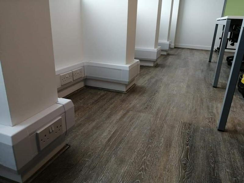 Image 18 - Power and data outlets installed within dado trunking in a Manchester city centre office.