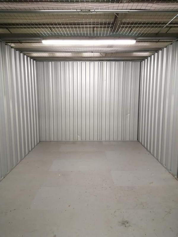Image 23 - Lighting and power installed within metal conduit in a commercial storage unit.