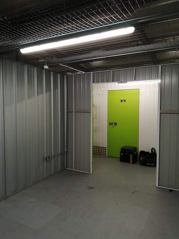 Image 24 - Lighting and power installed within metal conduit in a commercial storage unit.