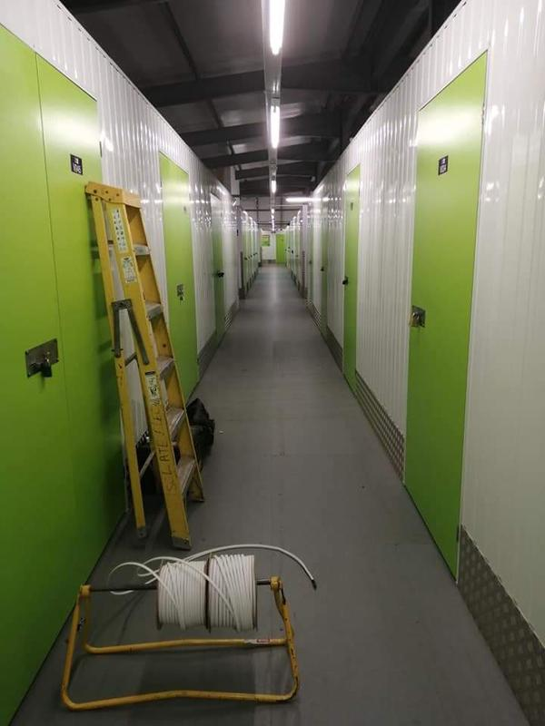 Image 25 - Lighting and power installed within metal conduit in a commercial storage unit.