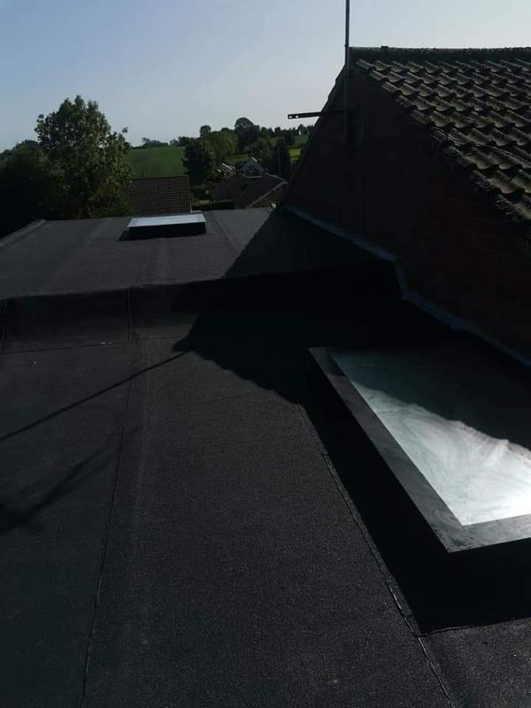 Image 13 - A 2 layer torch on felt system with 2 new roof lights fitted on an extension. 001