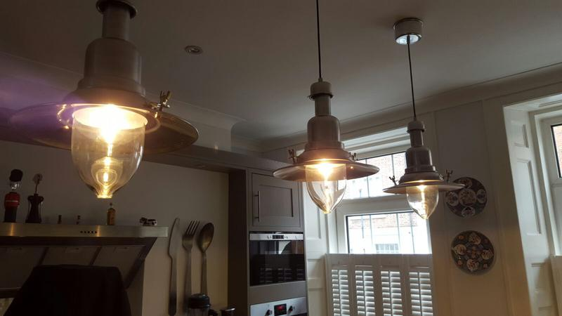 Image 13 - Feature lights installed over a kitchen centre isle.