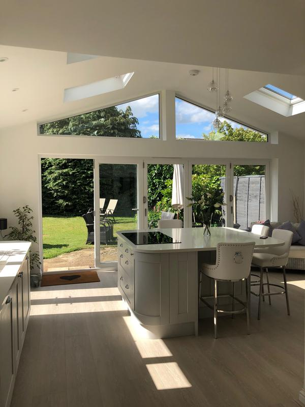 Image 14 - Kitchen extension with vaulted ceiling, roof lights, bifolds & shaped glass for maximum light.