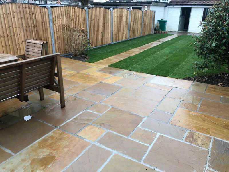 Image 21 - Indian sandstone patio with path, oval top fencing and lush new turf (grass).