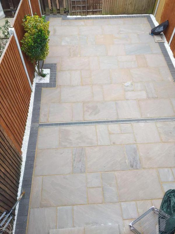 Image 9 - Indian Sandstone with grey charcoal edging and white decorative stone finish