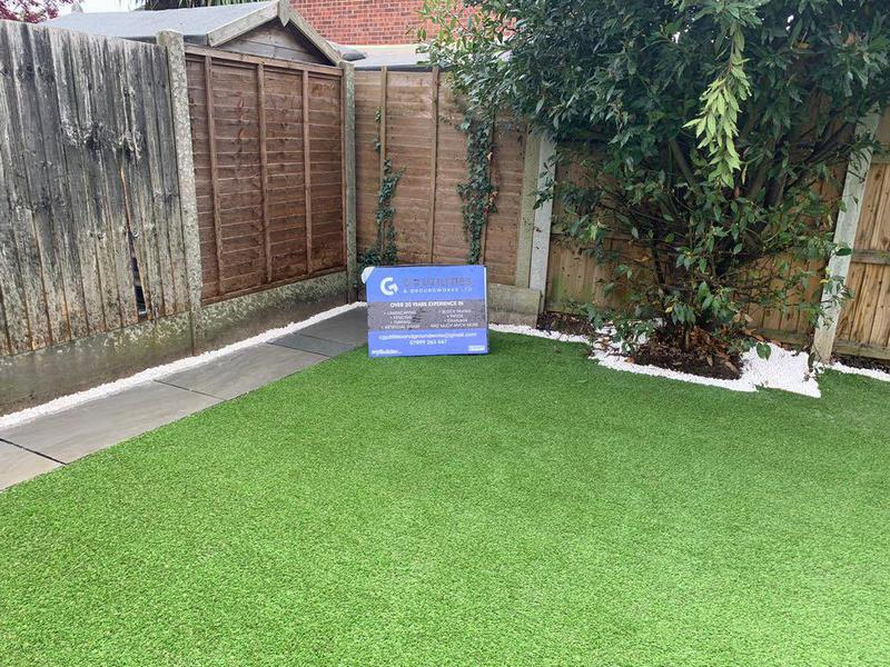 Image 15 - Artificial Grass & Grey Indian Sandstone Paving with white stone finish