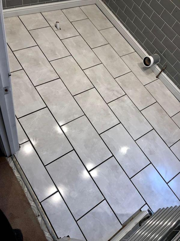 Image 18 - Nice fresh tile floor to update this customers bathroom.