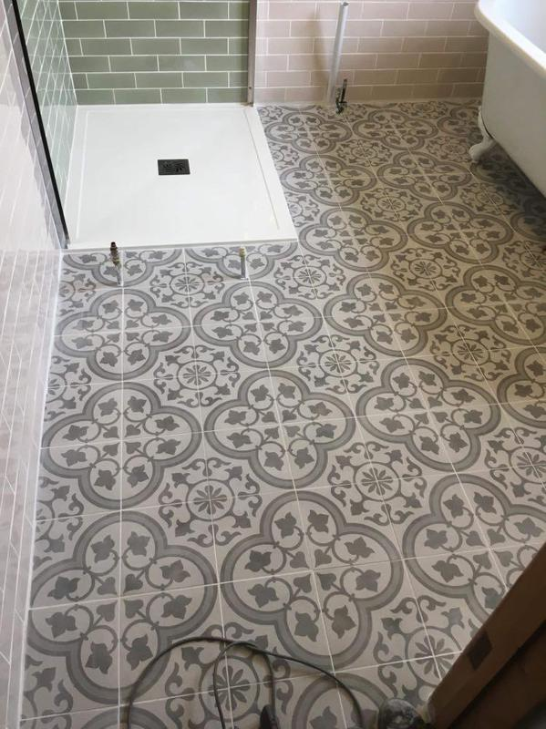 Image 38 - Freshly tiled floor with pipes ready for floor standing towel rail