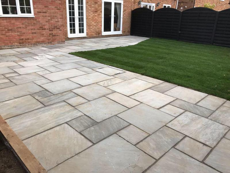 Image 77 - Indian sandstone patio and new turf in Harlow.