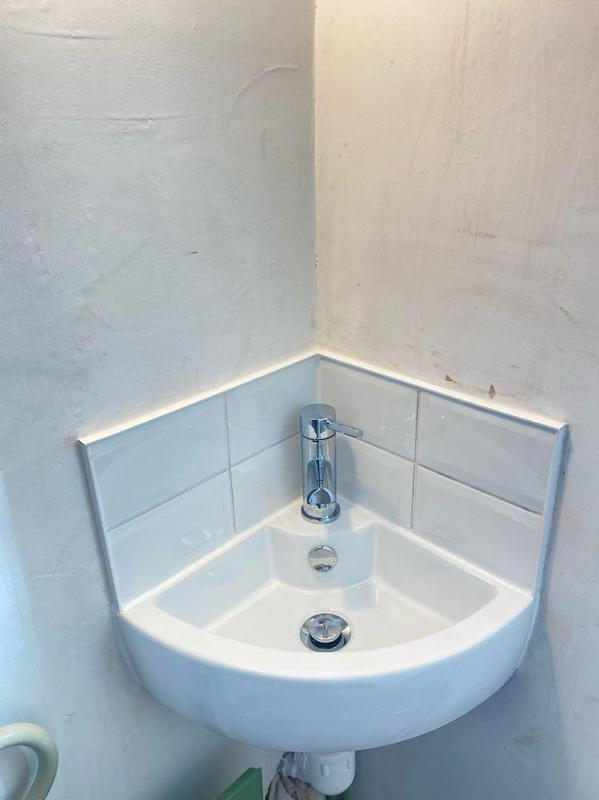 Image 3 - Replacement corner basin with new tiles and mixer tap