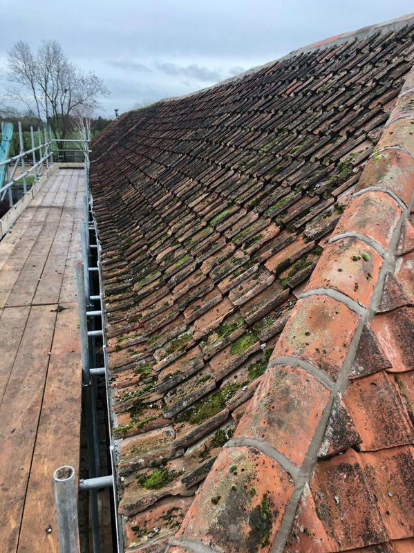 Image 4 - Replacement of felt and batten and existing tiles removed and re-fitted on barn conversion