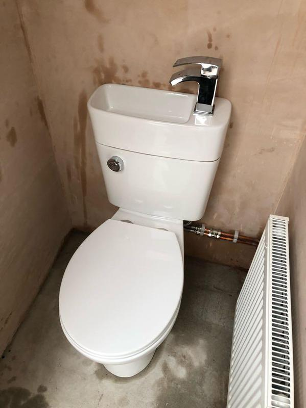 Image 23 - Space saving toilet with hand basin combo and new radiator.
