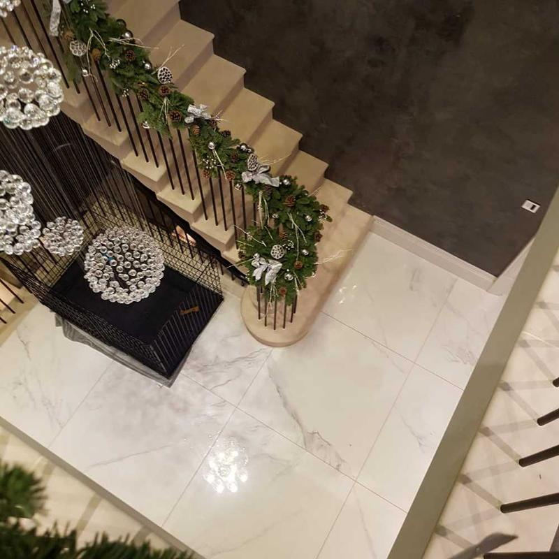 Image 3 - Stone staircase with floral rail decor. Lower floor is white calcatta effect porcelain large format. Ongar essex