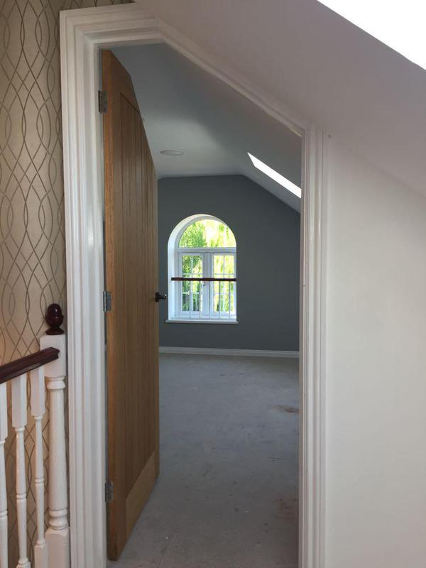 Image 3 - view from the new bathroom to new bedroom. arch aperture cut into gable end and window fitted