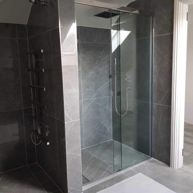 Image 13 - grey with white vein marble effect tile, ensuite shower room. chrome trim finish.