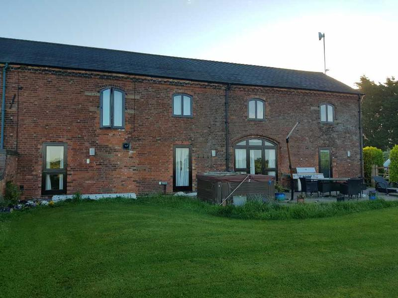 Image 34 - farm house has had 5 coats on windows and doors, guttering and down pipes painted black