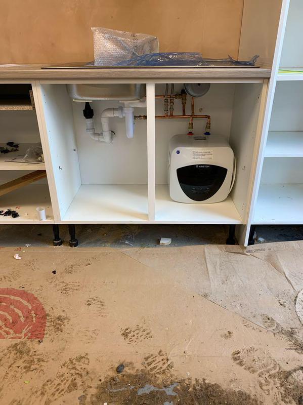 Image 76 - Under sink water heater fitted underneath a kitchen sink