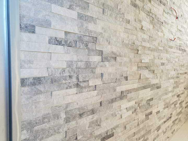 Image 9 - grey and white mix rock texture wall feature
