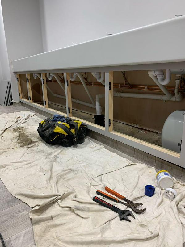 Image 58 - Sink installation in office building to include an under-sink water heater