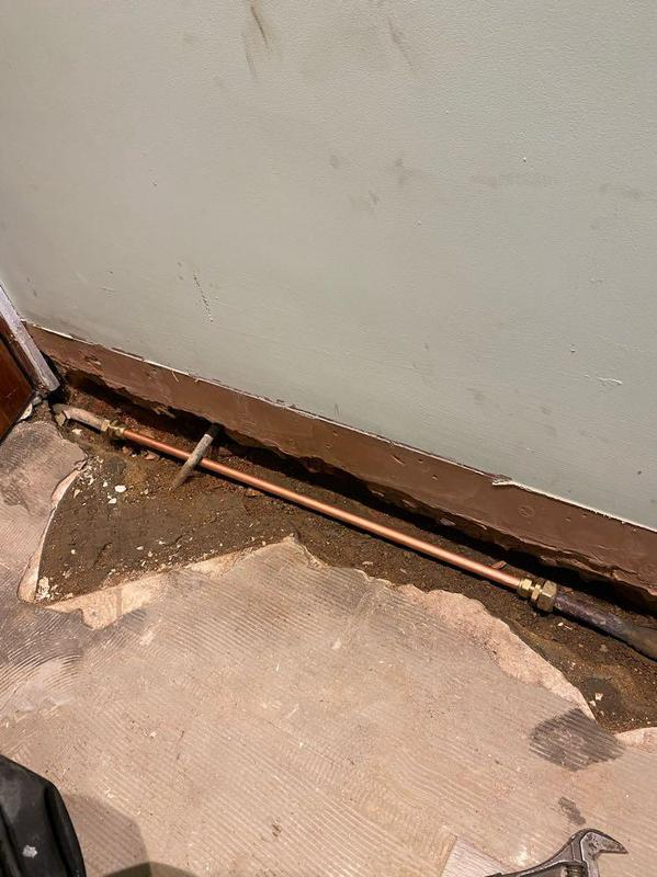 Image 2 - Lead pipe repair after it had burst under a partition wall.