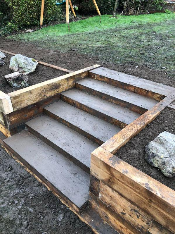 Image 51 - Retaining wall using timber sleepers, with strong staircase.