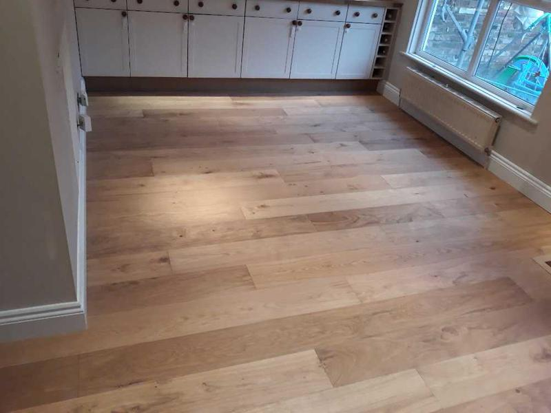 Image 24 - wood floor install - skirting