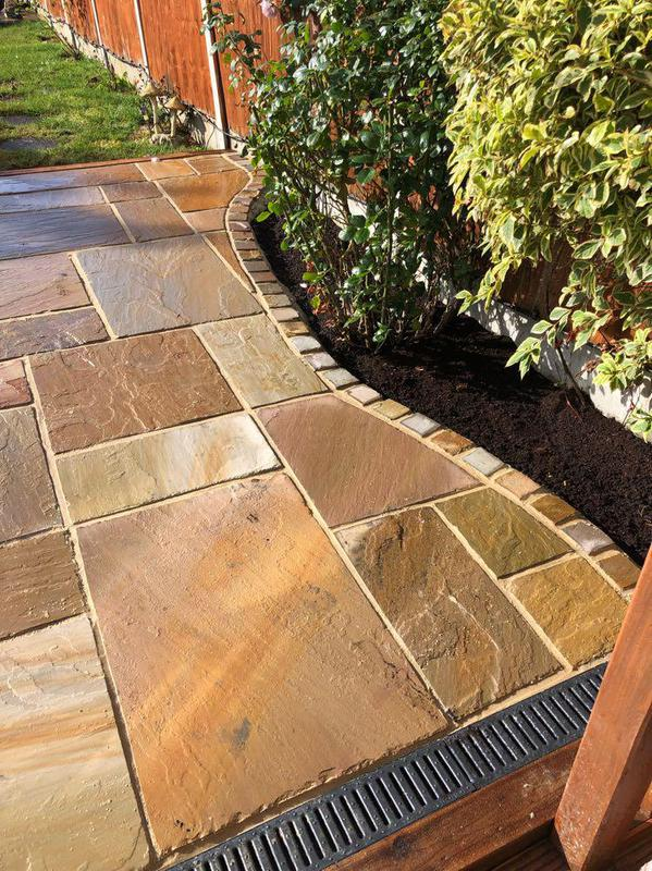 Image 26 - Indian sandstone with cobble edging.