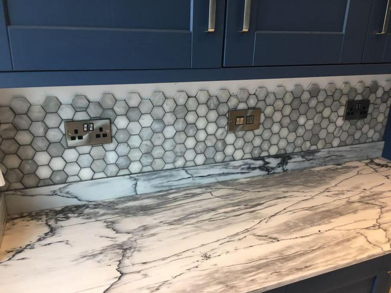 Image 195 - Hexagon marble mosaic installed with a grey grout