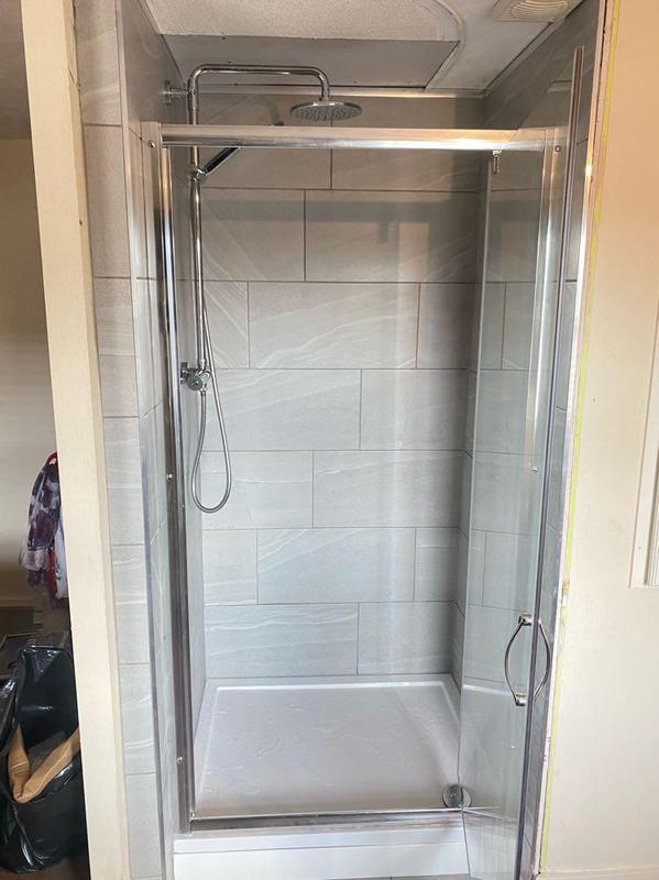 Image 30 - A small refurb on a shower cuble with porcelain tiles and a one piece glass
