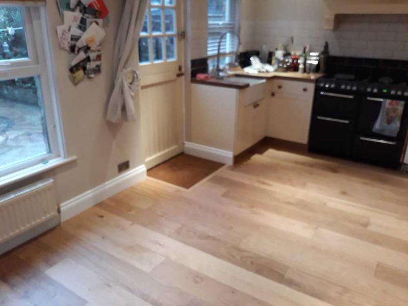 Image 23 - wood floor install - skirting