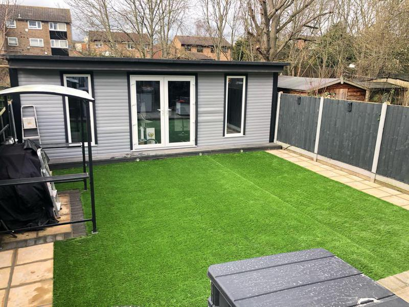 Image 27 - Artificial grass, with paving on each side.