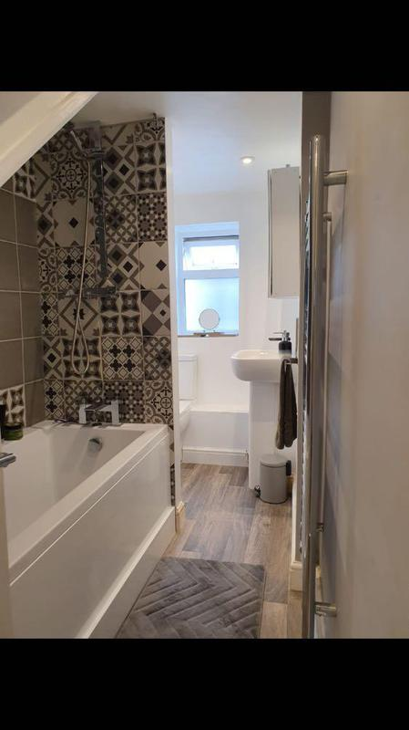 Image 45 - After with new stud wall tiling and shower