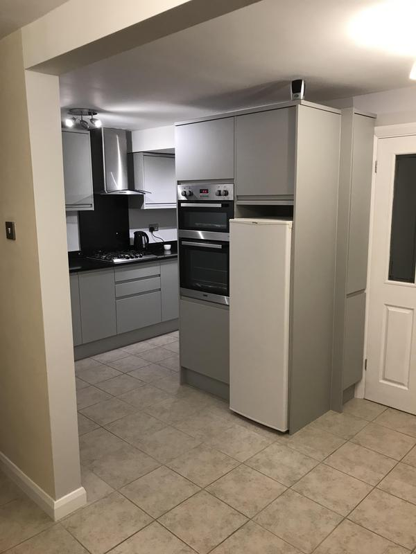 Image 6 - Customer 0142: Completed - All plastered, painted and new kitchen fitted. Making a kitchen open plan into the dining room. Now looks and feels more spacious. A very happy customer.