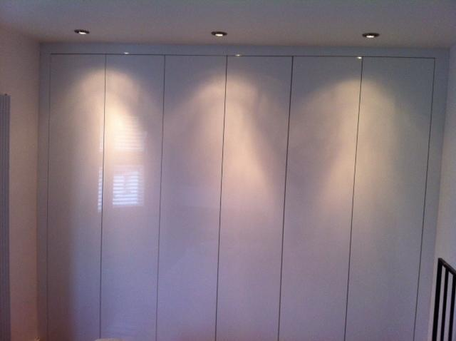 Image 43 - High gloss white robes with feature lighting. No handle push catch detail.
