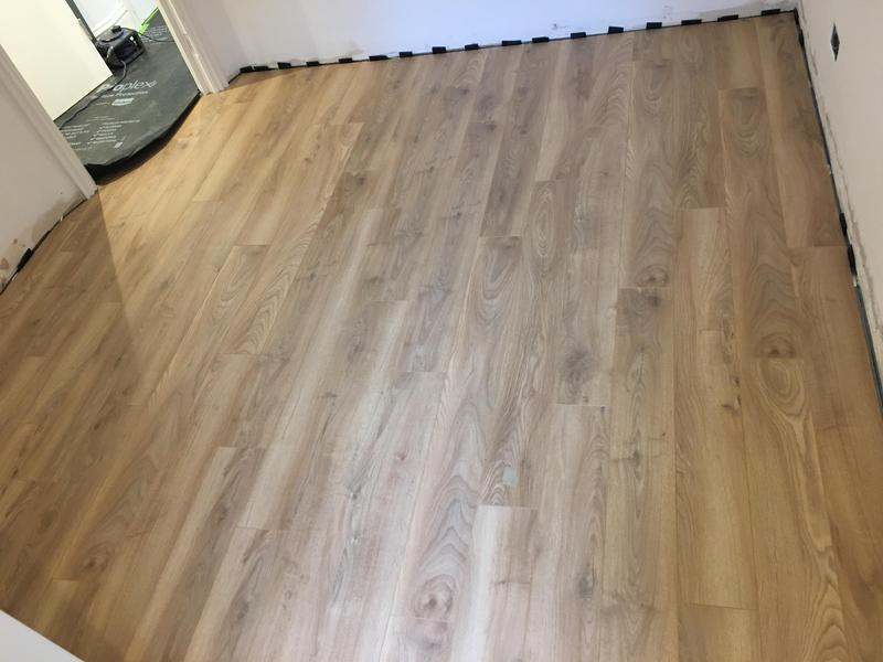 Image 66 - Plywood flooring sheets fitted, vapour barrier/sound and thermal underlay laid and then 14mm Oak laminate flooring