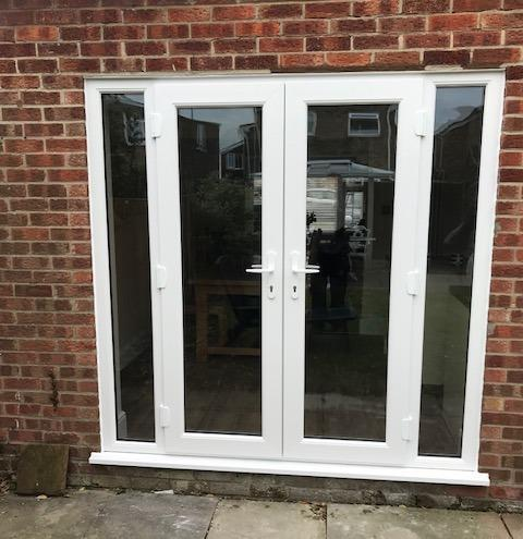 Image 52 - White uPVC french doors and side panels